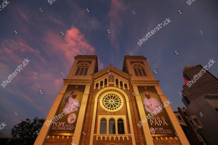 Huge posters of Pope Francis poster are displayed at the entrance of Assumption Cathedral in Bangkok, Thailand, . Pope Francis arrives in Thailand on Wednesday for the first visit here by the head of the Roman Catholic Church since St. John Paul II in 1984