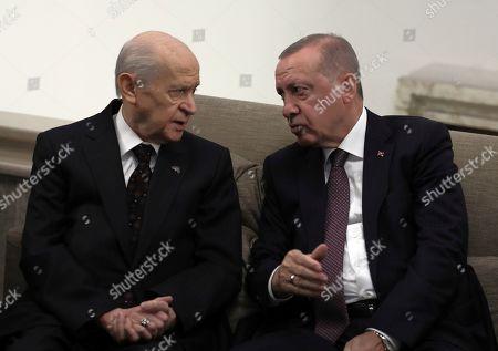 Recep Tayyip Erdogan, Devlet Bahceli. Turkish President Recep Tayyip Erdogan, right, speaks with Devlet Bahceli, the leader of opposition Nationalist Movement Party and Erdogan's main political ally, at the Parliament, in Ankara