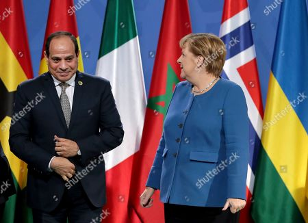 Stock Image of German Chancellor Angela Merkel, right, and Egypt's President Abdel Fattah al-Sisi, left, arrive for a group photo prior to a meeting at the chancellery as part of the 'Compact with Africa' conference in Berlin, Germany