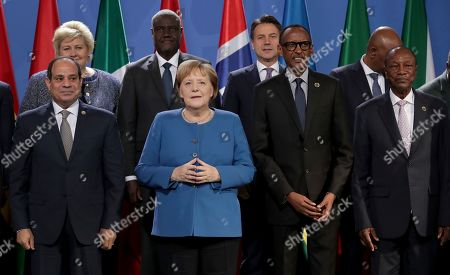 Front from left, Egypt's President Abdel Fattah al-Sisi, German Chancellor Angela Merkel, Ruanda's President Paul Kagame and Guinea's President Alpha Conde pose for a group photo prior to a meeting at the chancellery as part of the 'Compact with Africa' conference in Berlin, Germany