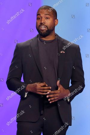 Stock Photo of Kanye West answers questions from Sr. pastor Joel Osteen during the 11 am service at Lakewood Church, in Houston