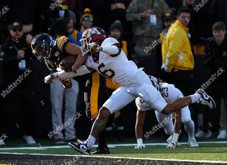 Nico Regain, Chris Williamson. Iowa wide receiver Nico Ragaini, left, dives into the end zone for a touchdown as Minnesota defensive back Chris Williamson trails during the first half of an NCAA college football game, in Iowa City, Iowa