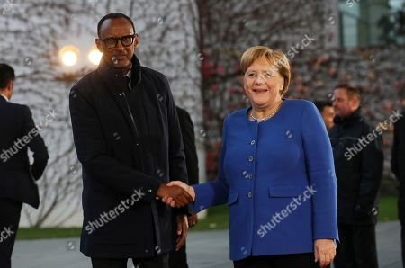 German Chancellor Angela Merkel (R) welcomes President of Rwanda Paul Kagame (L) in the Chancellery for the G20 Compact with Africa conference, in Berlin, Germany, 19 November 2019. The G20 Compact with Africa summit takes place from 18 to 20 November 2019.