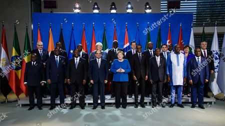 (L-R-front row) Ghanaian President Nana Akufo-Addo, Senegalese President Macky Sall, Ivorian President Alassane Ouattara, Egyptian President Abdel Fattah al-Sisi, German Chancellor Angela Merkel, Rwandan President Paul Kagame, Guinean President Alpha Conde, Burkinabe President Roch Marc Christian Kabore, Togolese Prime Minister Komi Selom Klassou; (L-R-second row) Executive Vice President and CEO of the International Finance Corporation Philippe Le Houerou, African Development Bank (AfDB) President Akinwumi Adesina, Ethiopian Minister of Water, Irrigation and Electricity Saleshi Bekele, Norwegian Prime Minister Erna Solberg, Chairman of the African Union Commission Moussa Faki, Italian Prime Minister Giuseppe Conte, Beninese Minster of Economy and Finance Romuald Wadagni, Moroccan Minister of Foreign Affairs Nasser Bourita, South African Finance Minister Tito Mboweni, The Managing Director of the International Monetary Fund (IMF) Kristalina Georgieva and Tunisian State Secretary for Foreign Affairs Sabri Bachtobji pose for a family picture during the G20 Compact with Africa summit at the chancellery in Berlin, Germany, 19 November 2019. The G20 Compact with Africa summit takes place from 18 to 20 November 2019.