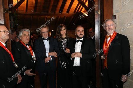 Christopher Lambert, journalist Ophelie Meunier and actor Francois-Xavier Demaison are inducted into the brotherhood of the Knights of Tastevin at the Chateau de Clos Vougeot during the 159th Hospices de Beaune wine auction