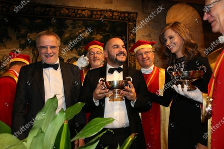 Christopher Lambert, actor Francois-Xavier Demaison and journalist Ophelie Meunier are inducted into the brotherhood of the Knights of Tastevin at the Chateau de Clos Vougeot during the 159th Hospices de Beaune wine auction