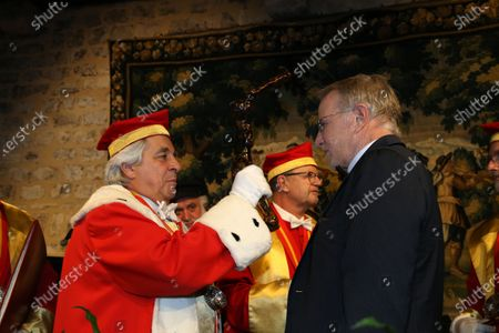 Actor Christopher Lambert is inducted into the brotherhood of the Knights of Tastevin at the Chateau de Clos Vougeot during the 159th Hospices de Beaune wine auction.