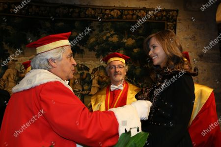 Journalist Ophelie Meunier is inducted into the brotherhood of the Knights of Tastevin at the Chateau de Clos Vougeot during the 159th Hospices de Beaune wine auction.