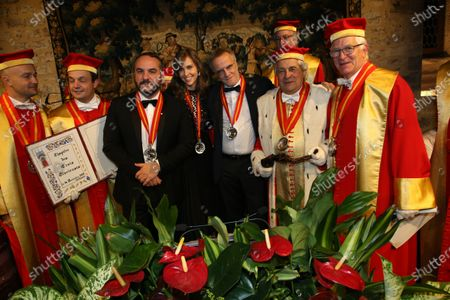 Actor Francois-Xavier Demaison, journalist Ophelie Meunier and Christopher Lambert are inducted into the brotherhood of the Knights of Tastevin at the Chateau de Clos Vougeot during the 159th Hospices de Beaune wine auction.