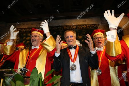 Stock Image of Christopher Lambert is inducted into the brotherhood of the Knights of Tastevin at the Chateau de Clos Vougeot during the 159th Hospices de Beaune wine auction.