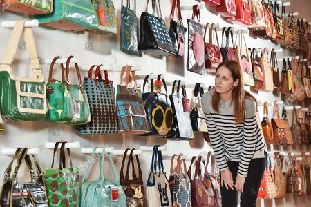 Exhibition visitor Sarah Bull admires some of the handbags on display at the Orla Kiely exhibition.