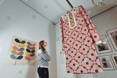 Exhibition visitor Sarah Bull admires one of the giant dresses on display at the Orla Kiely exhibition which features a design titled Velvet Spot Flower.