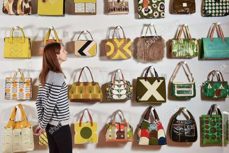Stock Image of Exhibition visitor Sarah Bull admires some of the handbags on display at the Orla Kiely exhibition.