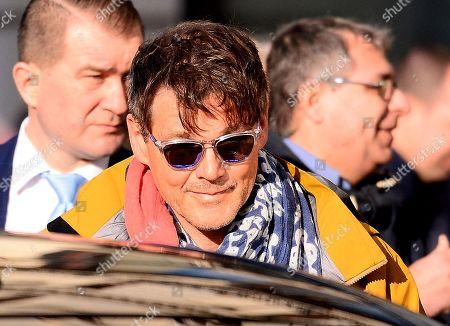 Morten Harket leaving a hotel in Warsaw