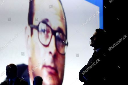 Stock Photo of French President Emmanuel Macron (R) watches a video clip paying a tribute to French former Mayor of Paris and President Jacques Chirac during the AMF congress, the annual meeting of French mayors in Paris, France, 19 November 2019.
