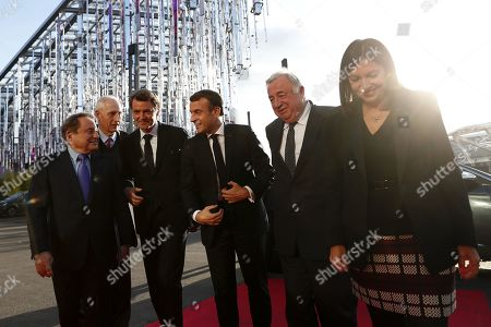 Stock Photo of French President Emmanuel Macron (C) is welcomed by AMF (Association des Maires de France) vice president Andre Laignel (L), Association of the Mayors of France (AMF) president Francois Baroin (2-L), French Senate president Gerard Larcher (2-R) and Mayor of Paris Anne Hidalgo (R) as he arrives at the AMF congress, the annual meeting of French mayors in Paris, France, 19 November 2019.