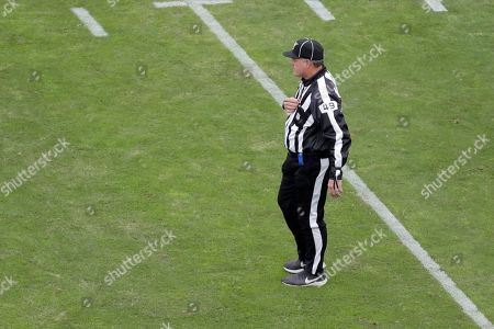 Stock Image of NFL umpire Rich Hall (49) looks on during the first half of an NFL football game between the Baltimore Ravens and the Houston Texans, in Baltimore
