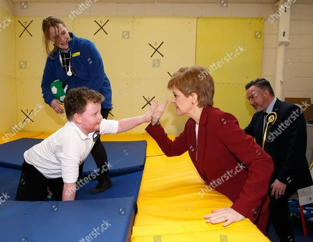 Scottish First Minister and SNP leader Nicola Sturgeon (2-R) plays with a child at the bOunceT Children's activity class, during a campaign trail with Alyn Smith (R), the SNP's candidate for Stirling, in Stirling, Britain, 19 November 2019. British Prime Minister Boris Johnson has called a general election for 12 December 2019.