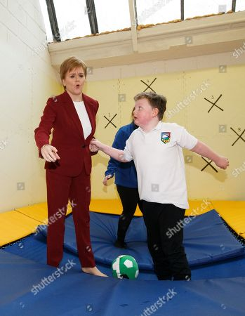 Scottish First Minister and SNP leader Nicola Sturgeon (L) plays with a child at the bOunceT Children's activity class, during a campaign trail with Alyn Smith, the SNP's candidate for Stirling, in Stirling, Britain, 19 November 2019. British Prime Minister Boris Johnson has called a general election for 12 December 2019.