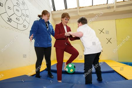 Scottish First Minister and SNP leader Nicola Sturgeon (C) plays with a child at the bOunceT Children's activity class, during a campaign trail with Alyn Smith, the SNP's candidate for Stirling, in Stirling, Britain, 19 November 2019. British Prime Minister Boris Johnson has called a general election for 12 December 2019.