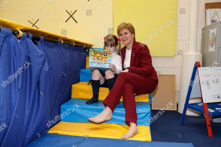 Scottish First Minister and SNP leader  Nicola Sturgeon (R) reads with a child, at the bOunceT Children's activity class, during a campaign trail with Alyn Smith, the SNP's candidate for Stirling, in Stirling, Britain, 19 November 2019. British Prime Minister Boris Johnson has called a general election for 12 December 2019.