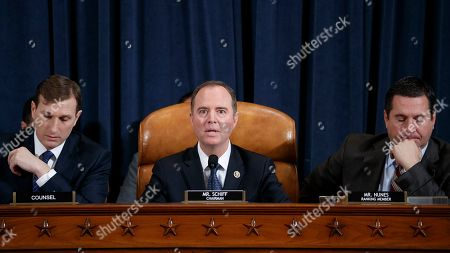 Democratic Chairman of the House Permanent Select Committee on Intelligence Adam Schiff (C), with Democratic legal counsel Daniel Goldman (L) and Ranking Member Devin Nunes (R), questions Special Advisor for Europe and Russia in the office of US Vice President Mike Pence, Jennifer Williams and Director for European Affairs of the National Security Council, US Army Lieutenant Colonel Alexander Vindman during the House Permanent Select Committee on Intelligence public hearing on the impeachment inquiry into US President Donald J. Trump, on Capitol Hill in Washington, DC, USA, 19 November 2019. The impeachment inquiry is being led by three congressional committees and was launched following a whistleblower's complaint that alleges US President Donald J. Trump requested help from the President of Ukraine to investigate a political rival, Joe Biden and his son Hunter Biden.