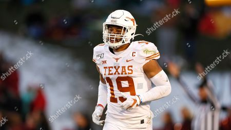 Texas defensive back Brandon Jones runs on the field during the second half of an NCAA college football game against Iowa State, in Ames, Iowa. Iowa State won 23-21