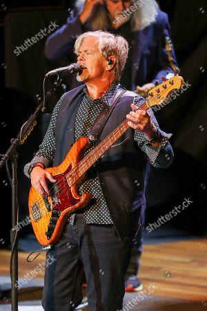 Stock Photo of John Cowan of The Doobie Brothers performs at The Doobie Brothers at Ryman Auditorium, in Nashville, Tenn