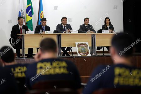 Authorities hold a press conference regarding the investigation into kickbacks and money laundering that they say involve Paraguay's ex-President Horacio Cartes, at Federal Police headquarters, in Rio de Janeiro, Brazil, . Brazilian police are seeking the arrest of the former president as part of the investigation