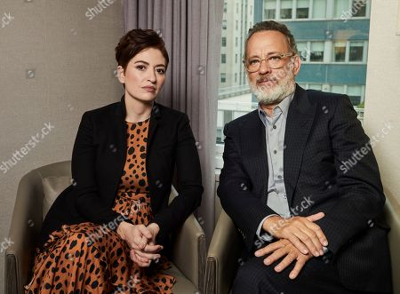 """Marielle Heller, Tom Hanks. This photo shows Marielle Heller, left, and Tom Hanks posing for a portrait in New York to promote their film, """"A Beautiful Day In The Neighborhood"""