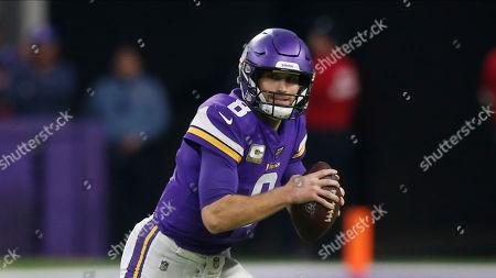 Minnesota Vikings quarterback Kirk Cousins throws against the Denver Broncos during an NFL football game, in Minneapolis