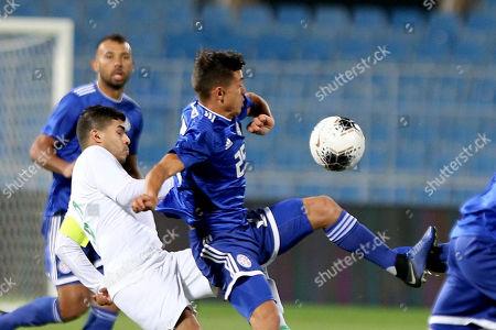Saudi Arabia player Yahya el Shehri (L) in action against Paraguay player Andres Cubas (R) during the International Friendly soccer match between Saudi Arabia and Paraguay at Prince Faisal bin Fahd Stadium, Al-Riyadh, Saudi Arabia, 19 November 2019.