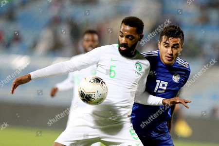 Saudi Arabia player Mohammed Khubrani (L) in action against Paraguay player Dario Lezcano (R) during the International Friendly soccer match between Saudi Arabia and Paraguay at Prince Faisal bin Fahd Stadium, Al-Riyadh, Saudi Arabia, 19 November 2019.