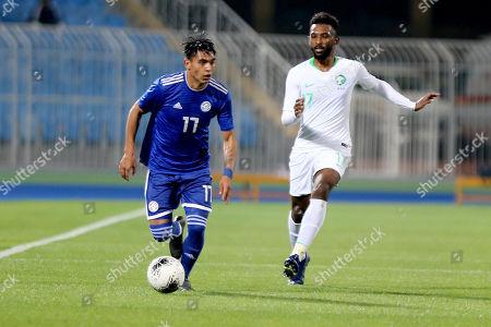 Saudi Arabia player Firas Al-Birakan (R) in action against Paraguay player Santiago Arzamendia (L) during the International Friendly soccer match between Saudi Arabia and Paraguay at Prince Faisal bin Fahd Stadium, Al-Riyadh, Saudi Arabia, 19 November 2019.