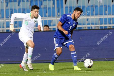Saudi Arabia player Abdullah Alhamddan (L) in action against Paraguay player Bruno Valdez (R) during the International Friendly soccer match between Saudi Arabia and Paraguay at Prince Faisal bin Fahd Stadium, Al-Riyadh, Saudi Arabia, 19 November 2019.