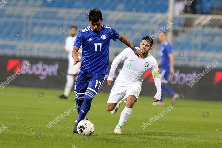 Saudi Arabia player Yahya el Shehri (R) in action against Paraguay player Santiago Arzamendia (L) during the International Friendly soccer match between Saudi Arabia and Paraguay at Prince Faisal bin Fahd Stadium, Al-Riyadh, Saudi Arabia, 19 November 2019.