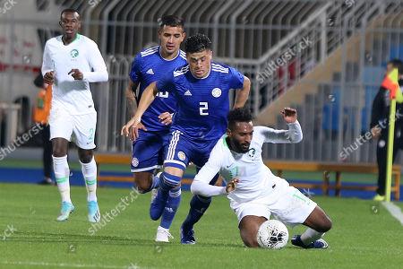 Saudi Arabia player Firas Al-Birakan (R) in action against Paraguay player Jorge Moreira (L)  during the International Friendly soccer match between Saudi Arabia and Paraguay at Prince Faisal bin Fahd Stadium, Al-Riyadh, Saudi Arabia, 19 November 2019.