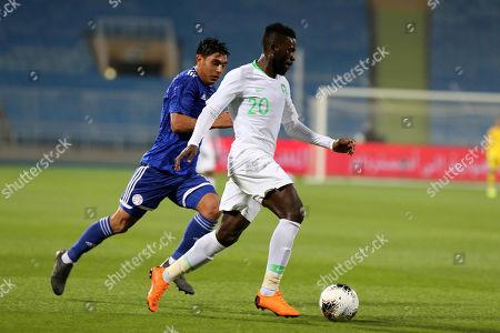 Saudi Arabia player Abdulaziz Al-Bishi (R) in action against Paraguay player Mathias Villasanti (L) during the International Friendly soccer match between Saudi Arabia and Paraguay at Prince Faisal bin Fahd Stadium, Al-Riyadh, Saudi Arabia, 19 November 2019.