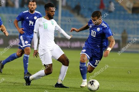 Saudi Arabia player Firas Al-Birakan (L) in action against Paraguay player Derlis Gonzalez (R) during the International Friendly soccer match between Saudi Arabia and Paraguay at Prince Faisal bin Fahd Stadium, Al-Riyadh, Saudi Arabia, 19 November 2019.