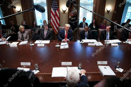 United States President Donald Trump speaks during a Cabinet Meeting in the Cabinet Room of the White House in Washington, DC. From left to right: US Secretary of Education Betsy DeVos, US Secretary of Veterans Affairs (VA) Robert Wilkie, The President, US Secretary of Housing and Urban Development (HUD) Ben Carson, US Secretary of Health and Human Services (HHS) Alex Azar.