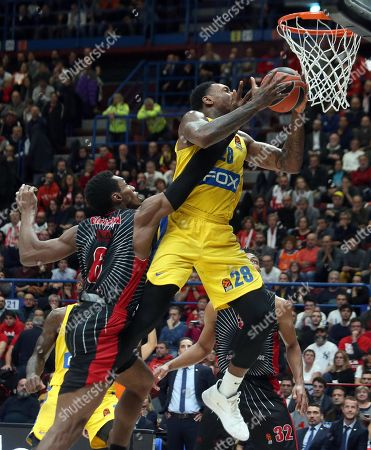 Maccabi Fox Tel Aviv's Tarik Black (R) in action against  Ax Armani Exchange Milan's Paul Biligha during the Euroleague basketball match between Armani Exchange Milan and Maccabi Fox Tel Aviv at the Assago Forum, Milan, Italy, 19  November  2019.