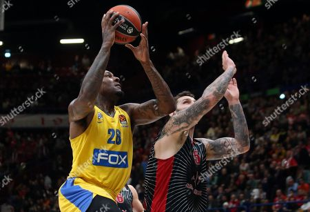 Stock Picture of Maccabi Fox Tel Avivs Tarik Black (L) in action against  Ax Armani Exchange Milan's Vladimir Micov during the Euroleague basketball match between Armani Exchange Milan and Maccabi Fox Tel Aviv at the Assago Forum, Milan, Italy, 19  November  2019.