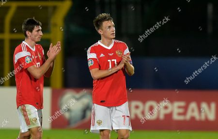 Russia's Zelimkhan Bakaev, left, and his teammate Aleksandr Golovin wave to supporters during the Euro 2020 group I qualifying soccer match between San Marino and Russia, in San Marino