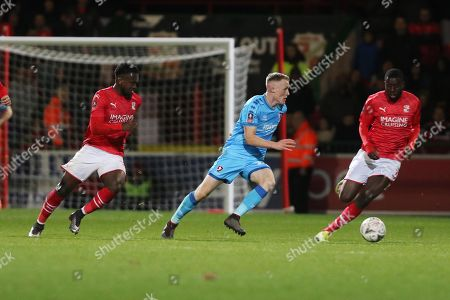 Diallang Jaiyesimi,Jake Doyle-Hayes  and Sido Sanokho   during the The FA Cup match between Swindon Town and Cheltenham Town at the County Ground, Swindon