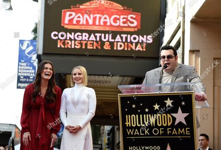 """Kristen Bell, Idina Menzel, Josh Gad. Idina Menzel, left, and Kristen Bell, cast members in """"Frozen 2,"""" react as fellow cast member Josh Gad speaks to the crowd during a dual Hollywood Walk of Fame star ceremony for Menzel and Bell, in Los Angeles"""