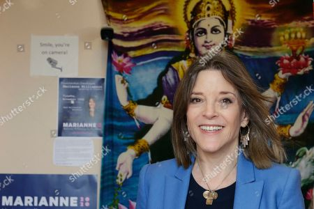 Democratic presidential candidate author Marianne Williamson leaves the Next Millennium Books & Gifts store after a campaign stop in Omaha, Neb