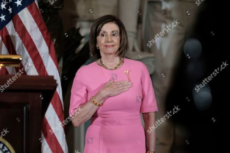 House Speaker Nancy Pelosi of Calif., attends a ceremony to unveil a portrait honoring former House Speaker John Boehner on Capitol Hill, in Washington