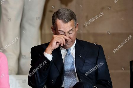 Former House Speaker John Boehner wipes tears during a ceremony to unveil a portrait honoring him on Capitol Hill, in Washington