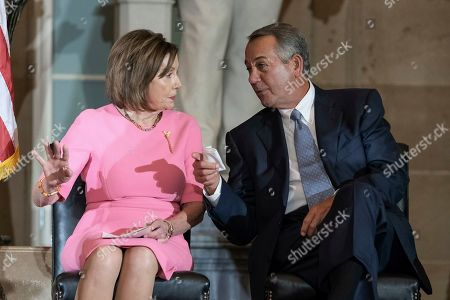 Stock Picture of House Speaker Nancy Pelosi of Calif., and former House Speaker John Boehner speak during a ceremony to unveil a portrait honoring Boehner on Capitol Hill, in Washington