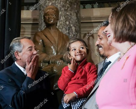 Stock Photo of Former Speaker of the House John Boehner, looks toward his grandchild during a ceremony to unveil a portrait of himself on Capitol Hill, in Washington